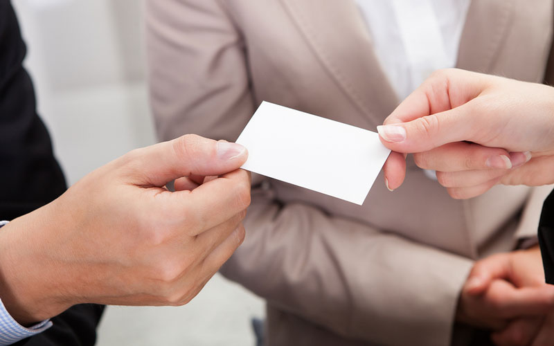 people exchaning business cards